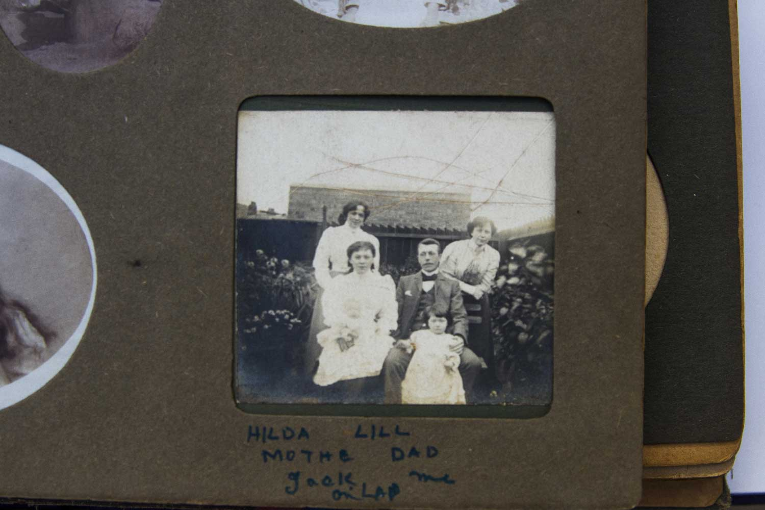 The three Suffragette Sisters. Left to right - (standing) Hilda Burkitt, (seated) Christobel Wood holding her baby son Jack, next to husband, Frederick George Wood holding daughter Kathleen, (standing) Lillian Burkitt. Date unknown, possibly around 1905 - Image Credit Lesley Cain, Jane Wood & Lauren Hall ( Great, Great / Great Nieces )
